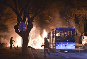 Firefighters work at a scene of fire from an explosion in Ankara, Wednesday, Feb. 17, 2016