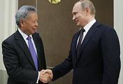 Цзинь Лицюнь и Владимир Путин