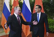 Президент РФ Владимир Путин и премьер Госсовета КНР Ли Кэцян