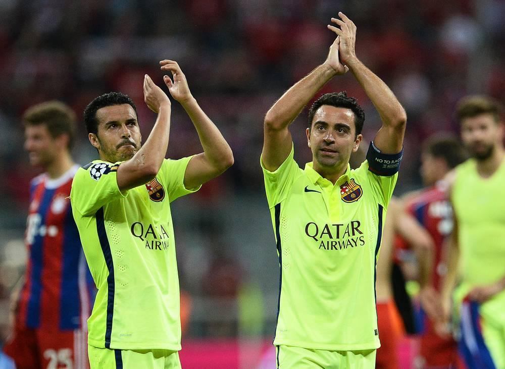 Хавбек каталонцев Хави (справа) вышедший на замену на 75-й минуте, стал первым игроком, который провел 150 матчей в Лиге чемпионов