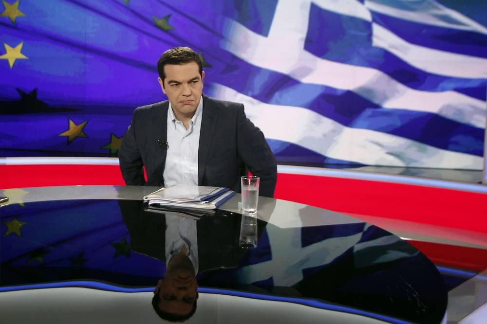 30 июня Греция пропустила срок очередного платежа по кредиту МВФ, став, таким образом, первой страной с развитой экономикой, не выполнившей свои финансовые обязательства перед фондом. На фото: премьер-министр Греции Алексис Ципрас