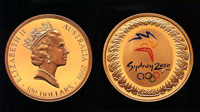 Памятные монеты, выпущенные в Австралии к летним Олимпийским играм 2000 в Сиднее. Фото AP Photo/Bernd Kammerer