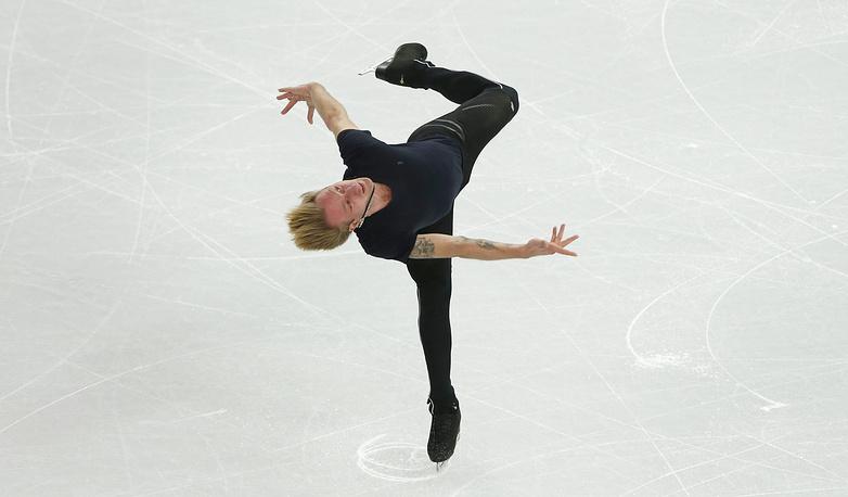 Евгений Плющенко на тренировке по фигурному катанию перед началом XXII зимних Олимпийских игр. 5 февраля 2014 г.