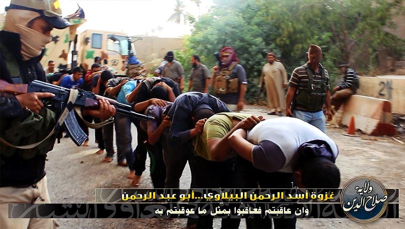 """Боевики из группировки """"Исламское государство Ирака и Леванта"""" захватили на этой неделе стратегически важный город Таль-Аффар на севере Ирака. В ходе столкновений погибло много иракских военных и мирных жителей.17 июня 2014 года"""
