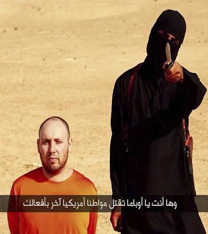 """3 сентября боевики группировки """"Исламское государство"""" (ИГ) обнародовали видео с казнью еще одного американского заложника - Стивена Сотлоффа"""