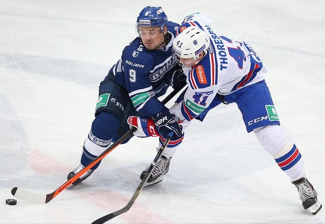 Алексей Цветков (слева) против Патрика Торесена