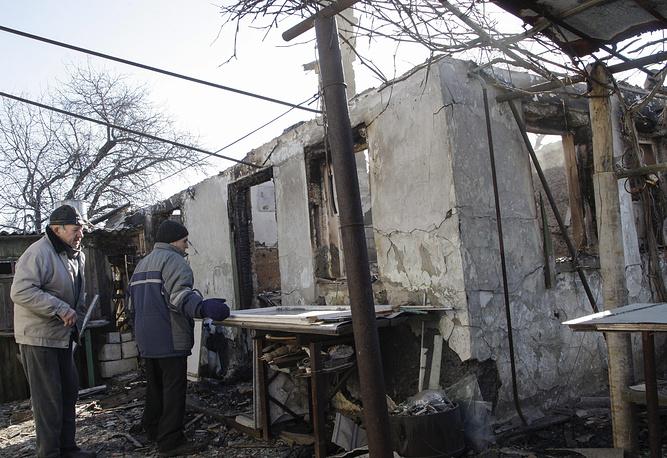 В то же время, по версии президента Украины Петра Порошенко, подразделения вооруженных сил Украины планово вышли из-под Дебальцева. Глава государства утверждал, что никакого окружения не было. На фото: Дебальцево после отвода украинских военных, 21 февраля 2015 года