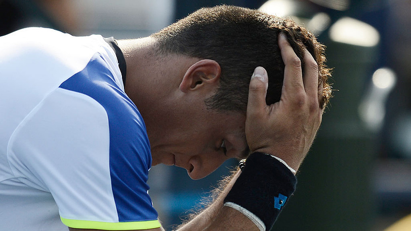 Испанец Николас Альмагро в матче против узбекского теннисиста Дениса Истомина в первом круге. Фото  EPA/ANDREW GOMBERT