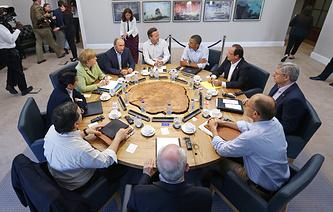Лидеры стран G8 во время рабочего заседания на курорте для гольфа в Лох-Эрн. Северная Ирландия. Июнь 2013 год