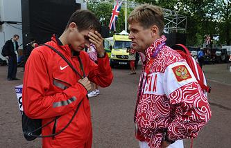 Спортсмен Владимир Канайкин и главный тренер по спортивной ходьбе Виктор Чегин