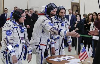 Американский космонавт Скотт Келли и российские космонавты Геннадий Падалка, Михаил Корниенко