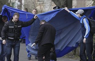 Оперативно-следственные мероприятия на месте убийства Олеся Бузины