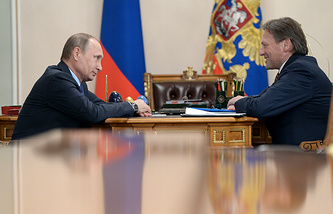 Президент РФ Владимир Путин и уполномоченный при президенте РФ по защите прав предпринимателей Борис Титов