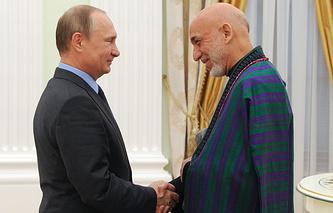 Президент России Владимир Путин и экс-президент Афганистана Хамид Карзай