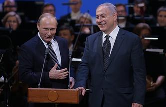 Владимир Путин (слева) и Биньямин Нетаньяху (справа)
