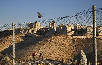 Палестинские рабочие на строительной площадке жилых домов, Маале-Адумим, Иерусалим, 7 февраля