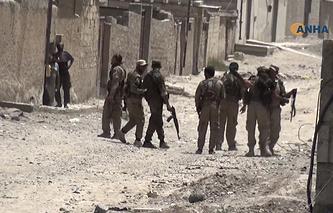 """Члены коалиции """"Силы демократической Сирии"""" в городе Ракка"""