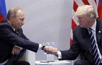 Президент РФ Владимир Путин и президент США Дональд Трамп на саммите G20 в Гамбурге, 7 июля