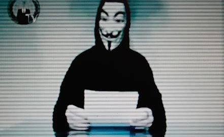 Скриншот размещенного в сети видео хакеров из группы Anonymous. Фото AP Photo/Petros Giannakouris