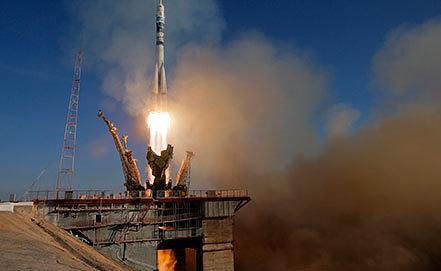 """Запуск корабля """"Союз ТМА-11М"""". AP Photo/Dmitry Lovetsky"""