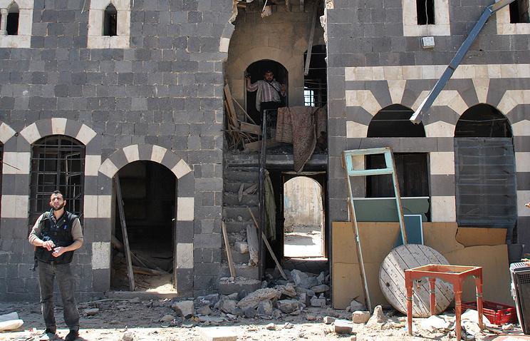 Архив. Поврежденное во время обстрела здание на базаре Хамидия