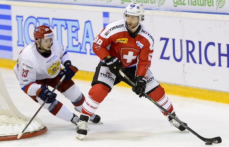 Эпизод из матча между сборными Швейцарии и России
