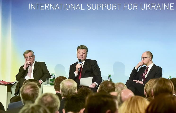 Президент Европейской комиссии Жан-Клод Юнкер, президент Украины Петр Порошенко и премьер-министр Украины Арсений Яценюк