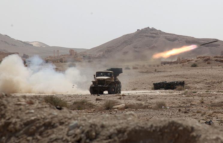 Сирийские военные в городе Пальмира