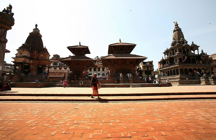 A combo of a picture (above) taken on 2008 April showing the Patan Durbar Square in Kathmandu, Nepal before the 25 April 2015 earthquake and a picture (below) taken on 20 May 2015 showing the Patan Durbar Square in Kathmandu after the 25 April 2015 earthquake. The death toll rose to 117, authorities said, separate from the 8,202 victims claimed by the April 25 earthquake. EPA/HARISH TYAGI