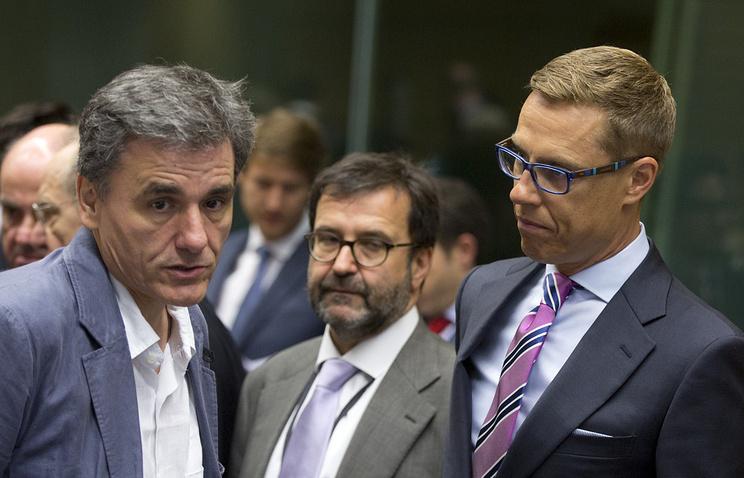 Министр финансов Греции Эвклидис Цаколотос и министр финансов Финляндии