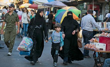 На одной из улиц Дамаска. Фото ИТАР-ТАСС/ Михаил Почуев